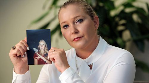 Virginia Giuffre holds a photo of herself at age 16, when she says Palm Beach multimillionaire Jeffrey Epstein began abusing her sexually.