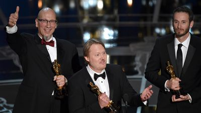 <b>Best Animated Feature Film:</b><br><br>Roy Conli, Don Hall and Chris Williams accept the Oscar for 'Big Hero 6'. (AAP)