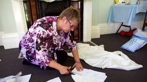 "Ms McKenna ""deconstructs"" a wedding dress. (Ehsan Knopf/9NEWS)"