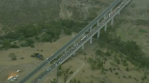 The car crashed on the EJ Whitten Bridge in Keilor East. (9NEWS)