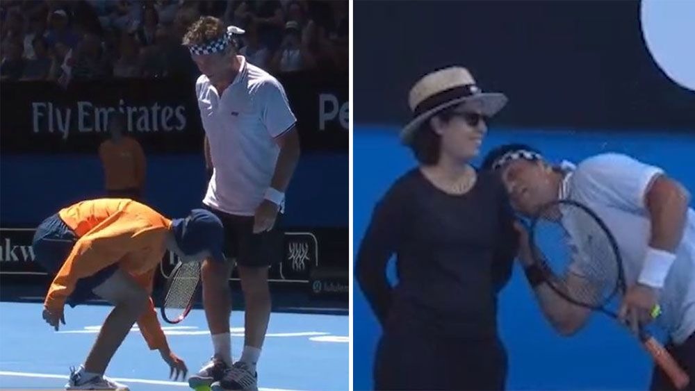 Australian tennis legend Pat Cash entertains crowd during mixed doubles match at Hopman Cup