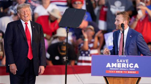 Donald Trump on stage with congressional candidate Max Miller.