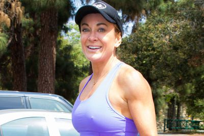 Here's Michelle in March 2014 pulling <i>au naturel</i> workout babe chic.