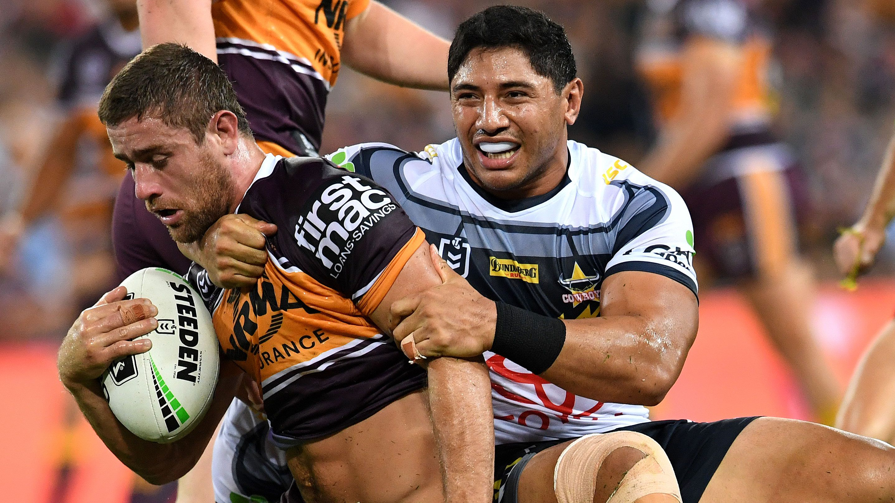 Jason Taumalolo tackles Andrew McCullough.