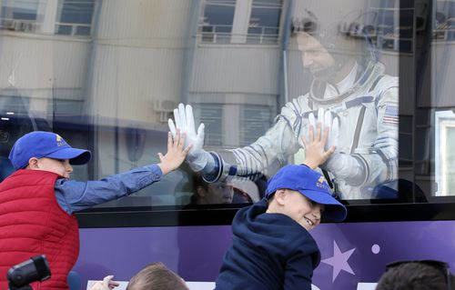 Hague waves to his sons as he boards the bus to the launch site.