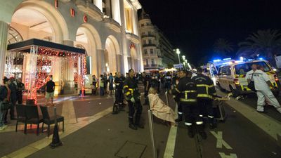 Wounded people are evacuated from the scene on Promenade des Anglais. (AAP)