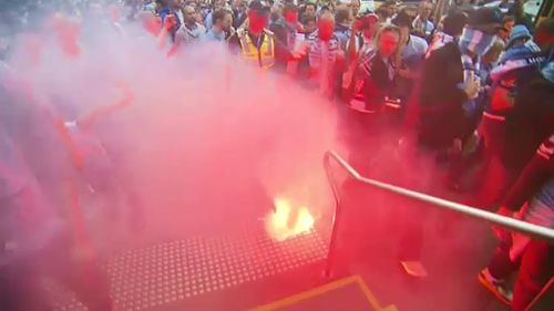 Anyone who lets a flare off inside a stadium is issued with a five-year ban. (9NEWS)