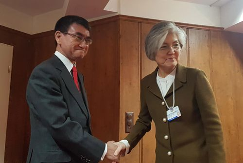 Japanese Foreign Minister Taro Kono (left) and his South Korean counterpart Kang Kyung-wha shake hands on the sideline of the World Economic Forum in Davos, Switzerland on January 23, 2019. Japan and South Korea will hold talks on bilateral issues such as South Korea radar lock-on incident.