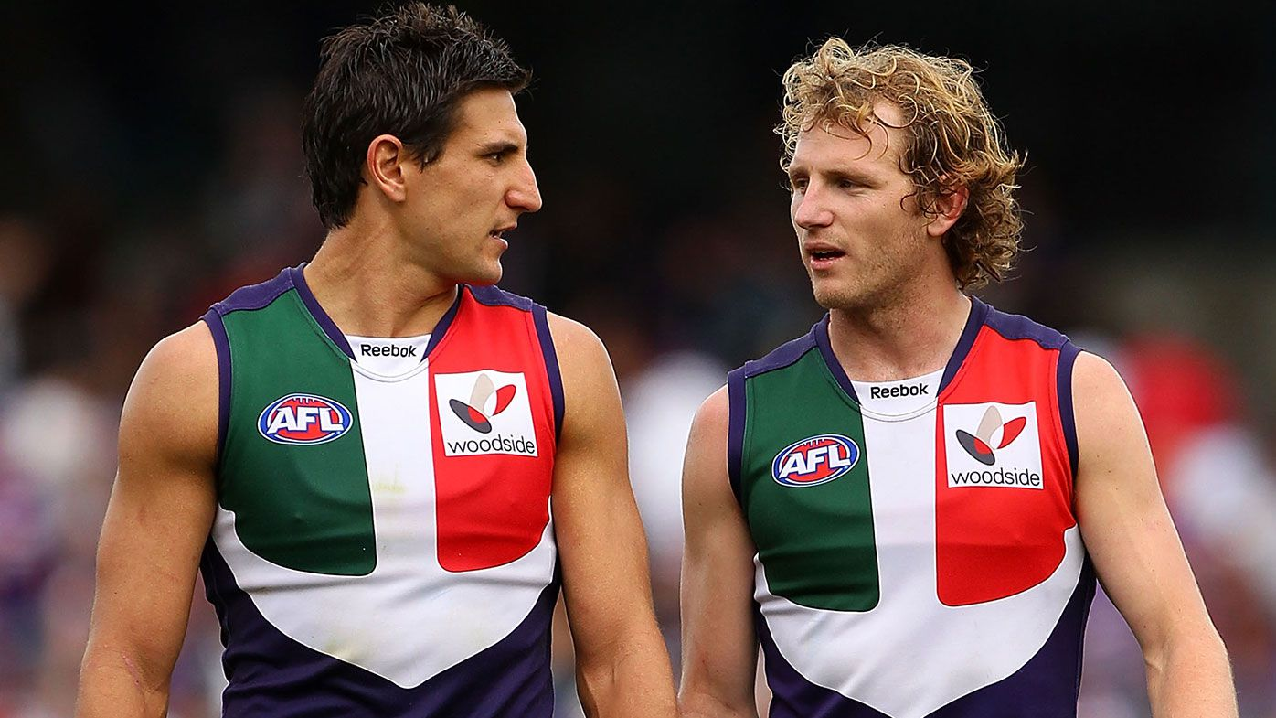 Matthew Pavlich and David Mundy of the Dockers talk as they walk to the three quarter time huddle during the AFL Second Elimination Final match between the Fremantle Dockers and the Hawthorn Hawks at Subiaco Oval on September 4, 2010 in Perth, Australia. (Photo by Paul Kane/Getty Images)