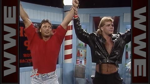 Marty Jannetty is thrown through a window by his tag team partner