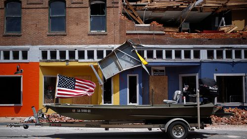 A US flag flies on a boat parked in front of a damaged building after Hurricane Laura made landfall in Lake Charles, Louisiana on Aug. 27.