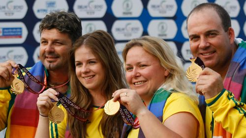 Michael Diamond (left) poses with a Commonwealth Games gold medal alongside fellow competitors Laetisha Scanlal, Stacy Roiall and Adam Vella. (AAP)