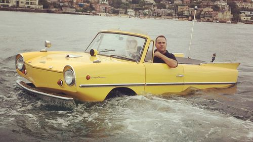 The Amphicar takes a splash in Sydney Harbour today.