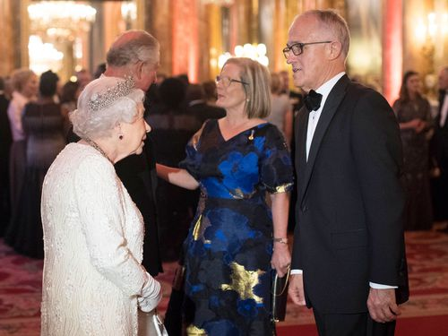 Queen Elizabeth II greets Australian Prime Minister Malcolm Turnbull and Prince Charles greets Lucy Turnbull at the CHOGM reception. (AAP)