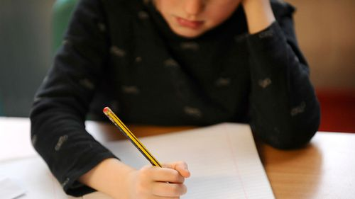 Around one in five parents dedicate their savings to their children's education, a new study has found. (AAP)