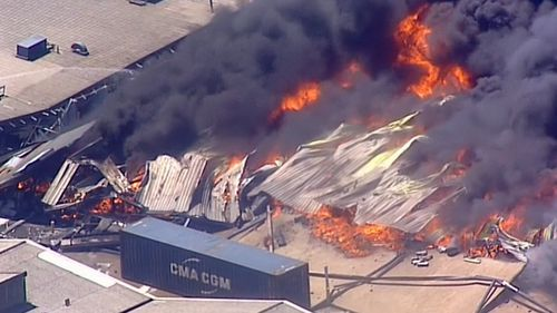 At least 100 firefighters battled the blaze.