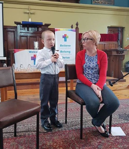 Jack singing in church while his mum watches on.