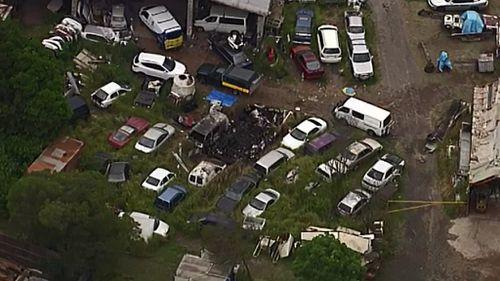 The fatal caravan fire happened at a smash repairs business in Darra. (9NEWS)