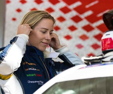 Emily Duggan race car driver preparing for a race