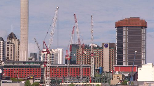 Cranes aiding the construction of new high-rises in Auckland (A Current Affair)