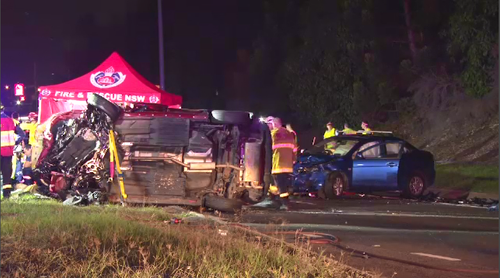 An 18-year-old man died at the scene of a fiery crash in Sydney's southwest overnight that involved eight cars. Picture: 9NEWS.