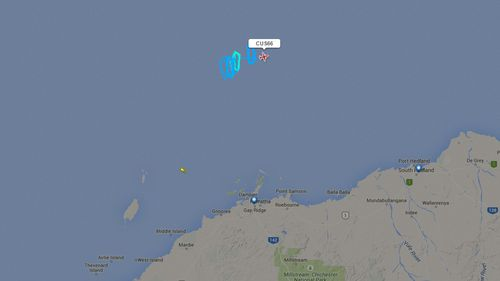 A Dash-8 plane registered to Surveillance Australia has been circling waters off Dampier. (Flightradar24)