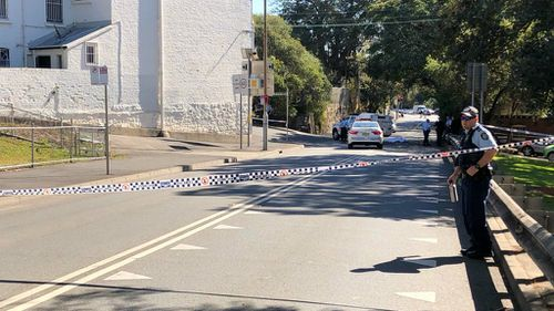 It's believed the man, aged in his 20s, was heard fighting with a man and a woman inside a house before staggering out onto the street covered in blood, suffering serious head injuries.