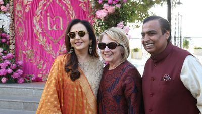 Mukesh Ambani (right) and his wife receive Hillary Clinton