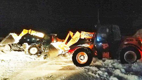 Tractors clearing snow in Chernihiv, Ukraine.