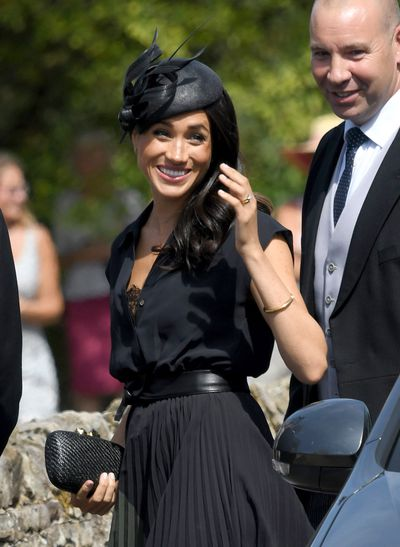 Meghan Markle in Club Monaco at the wedding of friends' Charlie van Straubenzee and Daisy Jenks