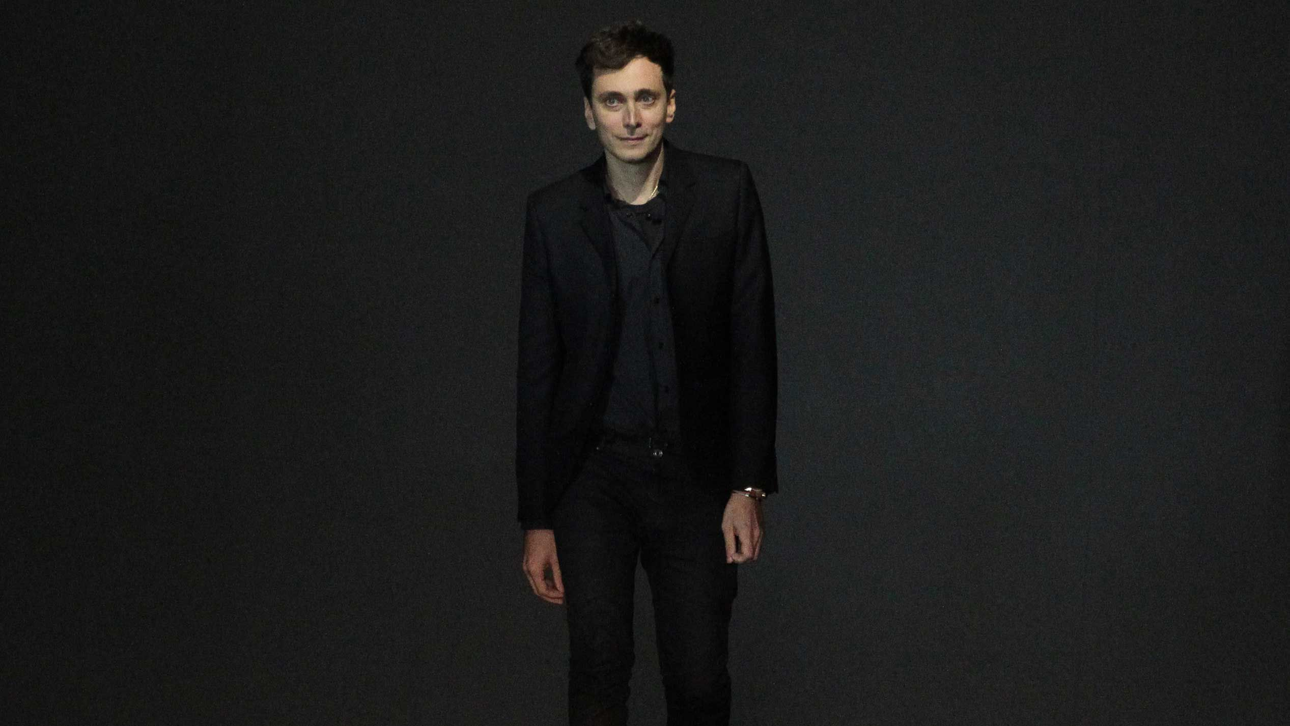 Hedi Slimane is suing Saint Laurent's parent company