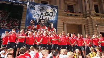 Despite being without the hometown advantage, plenty of Swans fans turned out to see their team stand on stage. (Getty Images)