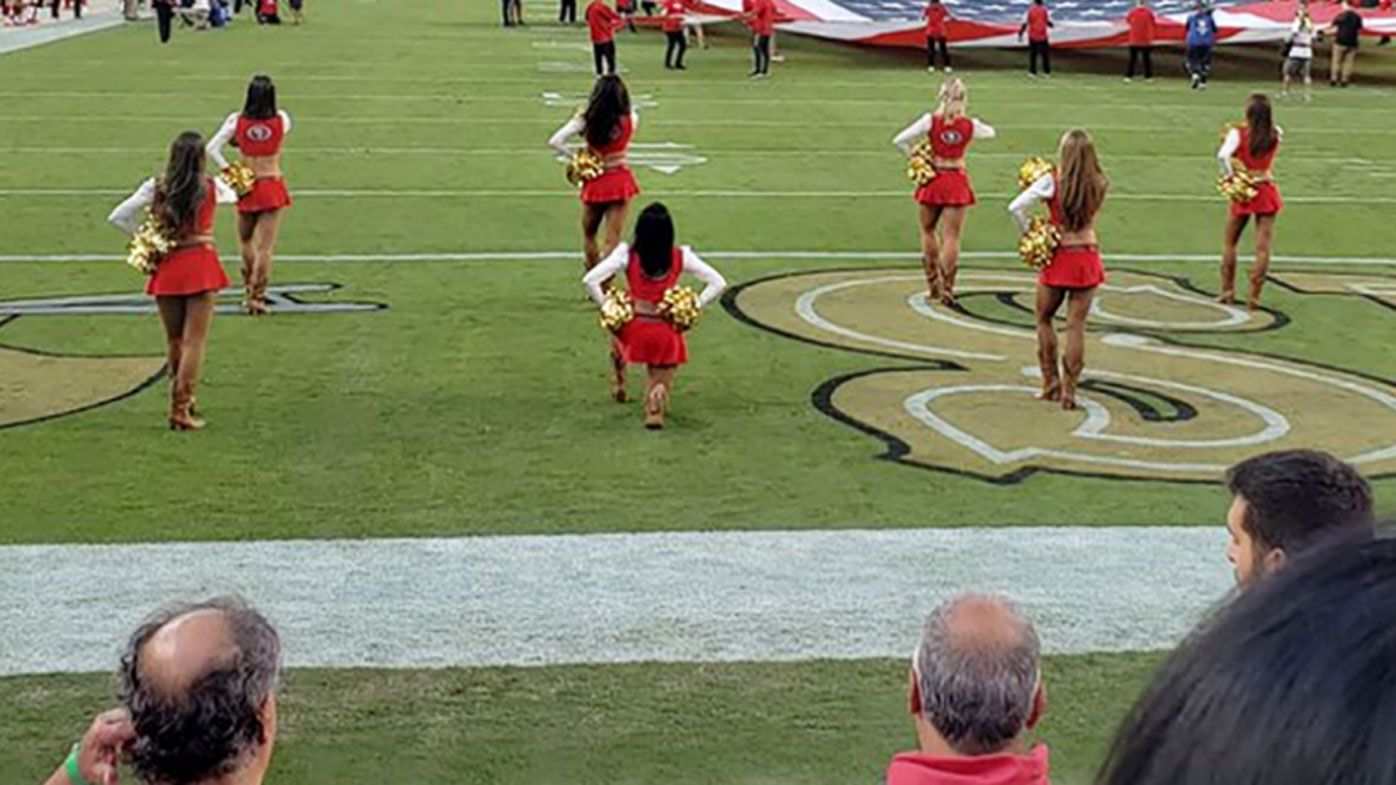 San Francisco 49ers cheerleader takes knee during US national anthem