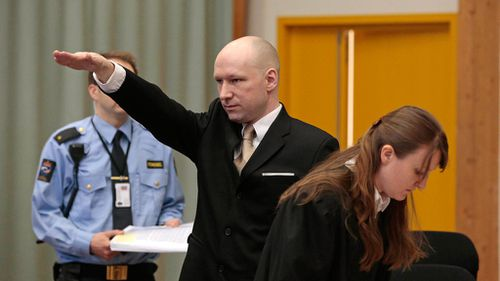 Anders Behring Breivik gestures as he enters a courtroom in Skien, Norway. (AAP)