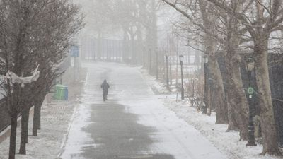 A person runs through East River Park ahead of a large winter storm in New York. (AAP)