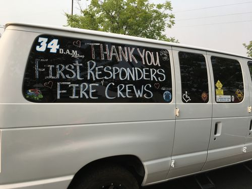 A thank you to fire crews and first responders is shown on a van in Redding. Picture: AP
