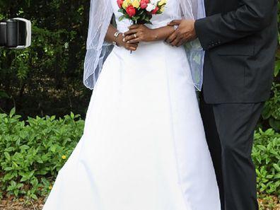 Female wedding photographer with couple