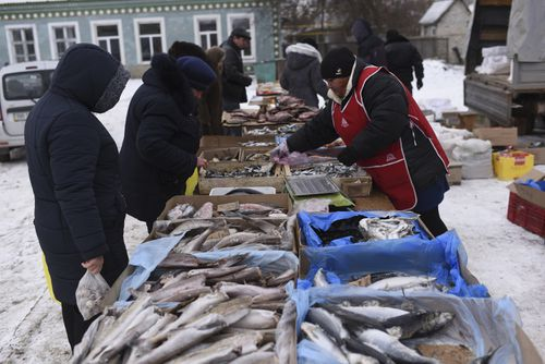 Saturday's fish market in Milove. Few Russians venture over to buy produce these days.