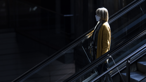 Woman wears a face mask at the central station on the first day of a nationwide policy to wear protective face masks in public during the novel coronavirus crisis on April 27, 2020 in Berlin, Germany.