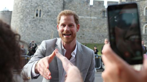 Prince Harry met with well-wishers at Windsor before his big day. (Getty)