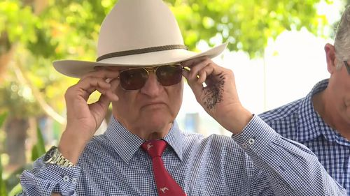 Mr Katter appeared to have written prompts on his hand before addressing the media today.