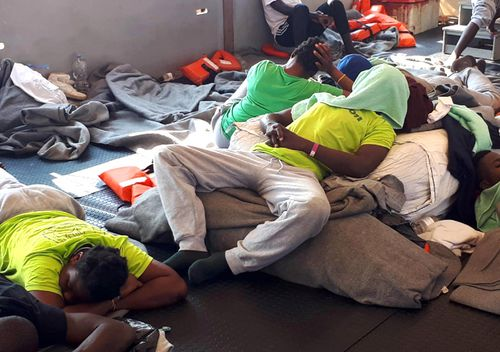 Some migrants on board the vessel Sea-Watch 3 at sea in the Mediterranean, 27 June 2019