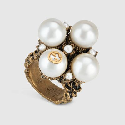 """<p>Engaged</p> <p><a href=""""https://www.gucci.com/au/en_au/pr/jewellery-watches/fashion-jewellery/rings/textured-ring-with-glass-pearl-buds-p-448799J1D868082?position=7&listName=SearchResultGridComponent"""" target=""""_blank"""" draggable=""""false""""><strong>Gucci</strong></a> textured ring with glass pearl buds, $470</p>"""