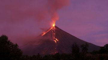 Lava flows down the slopes of Mayon volcano during its eruption in the Philippines in January
