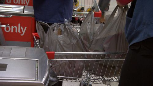 The plastic bag ban could mean forgetful shoppers have to fork out extra to carry their shopping.