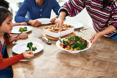 Family eating healthy dinner together