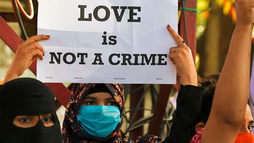 A protester during a demonstration in opposition to proposed laws against 'Love Jihad' in Bangalore.
