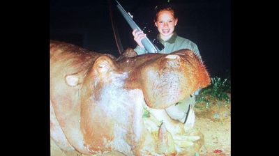 The Texas teenager has been hunting since she was a child. Here she poses with a hippo she shot when she was 14.