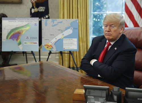 President Donald Trump pauses during his meeting to discuss potential damage from Hurricane Michael, in the Oval Office of the White House