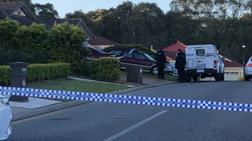 Police at the Woodcroft home this morning.